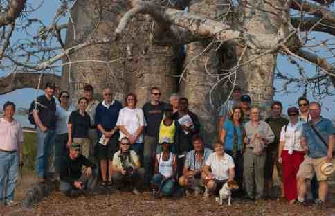 Angola Field Group Members gather together in front of a  baobob tree during the August 2 field trip to  the Miradouro da Lua (the Lunar Landscape).