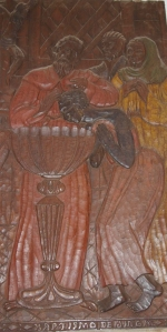 Details from wooden carving in The Church of Jesus, showing baptism of Queen Ginga