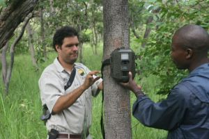 Pedro and a shepherd wtih a digital trap camera.