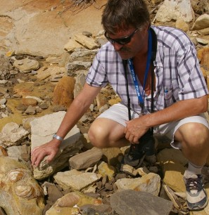 Geologist Tako Koning examining