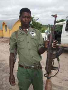 Palanca shepherd holds AK 47