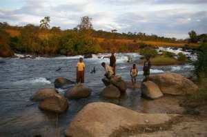 Boys playing in the Chicapa River, one of the many diamond bearing rivers and streams in the Lundas where alluvial diamonds abound.