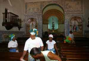 Women cleaning the church for the Sabbath, Igreja de Nossa da Nazaré, built 1634 - 35, one of the churches we will visit.