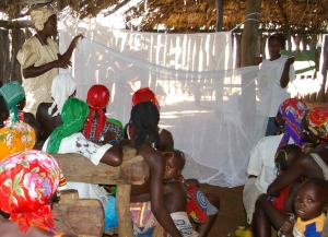Encouraging use of impregnated mosquito nets. Lutheran Church Malaria Awareness Campaign in Cunene Province.