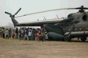 Excited villagers gather around military helicopter translocating a male giant sable. Photo courtesy Barni O'Hara.
