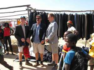 Trying on vintage jackets in Huambo city's big informal market, 'Mercado Alemanha' on May field trip to Huambo.