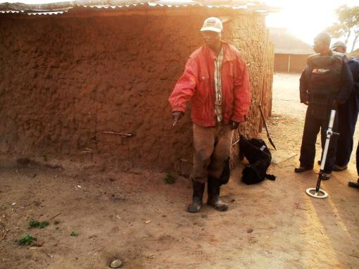 A lethal threat in his own backyard. A resident shows MAG de-mining team a landmine