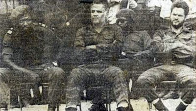 Prisoners of war. Colonel Manuel Rojas Garcia, centre, Captain Ramón Aguilar, right.
