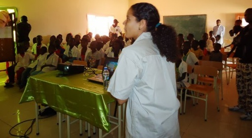 Sendi making a educational presentation for public schools in Cangandala.
