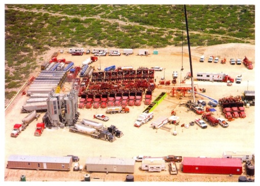 Fracking operations are typified by tight arrangement of pressure pumping trucks. Shown is fracking of the Eagle Ford shale of South Texas, USA.  Photo courtesy of Halliburton